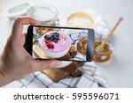 taking photos of breakfast to... | Shutterstock . vector #595596071