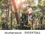 happy school girl enjoying... | Shutterstock . vector #595597061