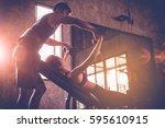 sporty girl doing weight... | Shutterstock . vector #595610915