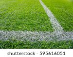 background of wet green grass... | Shutterstock . vector #595616051