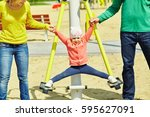 child with parents at the... | Shutterstock . vector #595627091