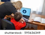 Small photo of Mother locking on computer for son, parental control
