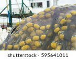 an yellow fishnet in front of... | Shutterstock . vector #595641011