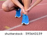 runner with injured ankle on... | Shutterstock . vector #595643159