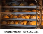baking bread in a professional... | Shutterstock . vector #595652231