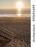 late afternoon on the beach of... | Shutterstock . vector #595691699
