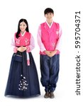 Small photo of Young couple standing with both hands together in korean traditional dress