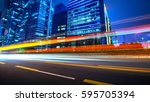 the light trails on the modern... | Shutterstock . vector #595705394