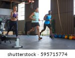 three people racing running... | Shutterstock . vector #595715774