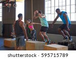 crossfit class jumping on... | Shutterstock . vector #595715789