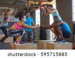 instructor giving encouragement ... | Shutterstock . vector #595715885