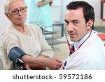 doctor examining a patient | Shutterstock . vector #59572186