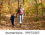 mother and son taking a walk in ... | Shutterstock . vector #59572207