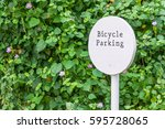 bicycle parking sign in the park | Shutterstock . vector #595728065