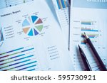 many charts and graphs with pen ... | Shutterstock . vector #595730921