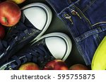sneakers  jeans and red apples | Shutterstock . vector #595755875