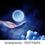 moon planet in hand . mixed... | Shutterstock . vector #595774691