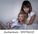 sister teen sad. hugging the...   Shutterstock . vector #595796219