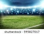 football pitch and blue lights  | Shutterstock . vector #595827017