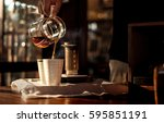 barista pour the coffee into... | Shutterstock . vector #595851191