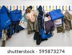 rack of coats on pegs | Shutterstock . vector #595873274
