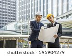 team of engineers discussing... | Shutterstock . vector #595904279