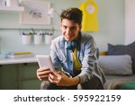 he is always on line with his... | Shutterstock . vector #595922159