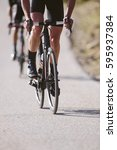group of cyclists riding a bike ... | Shutterstock . vector #595937384