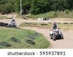 young man driving quad bike... | Shutterstock . vector #595937891