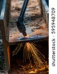 Small photo of cutting a hole in a steel beam using an acetylene torch