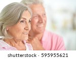happy elderly couple embracing | Shutterstock . vector #595955621