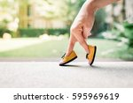 Stock photo woman hand finger walking with shoe concept 595969619