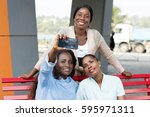 young women sitting on a bench... | Shutterstock . vector #595971311