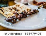 Small photo of Turkish Cag kebab doner on skewers. copy space.