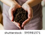 a handful of soil.soil in... | Shutterstock . vector #595981571