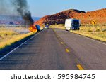 a vehicle burning along us... | Shutterstock . vector #595984745