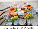 picnic on the beach at sunset... | Shutterstock . vector #595986785