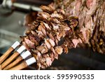 Small photo of Turkish Cag Kebab Doner on skewers in wood fired oven.