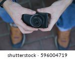 hipster with camera | Shutterstock . vector #596004719