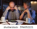 the elderly couple considers... | Shutterstock . vector #596052221