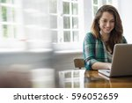 smiling woman with laptop in... | Shutterstock . vector #596052659