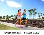 happy couple of runner friends... | Shutterstock . vector #596066669