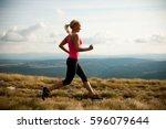 runner   woman runs cross... | Shutterstock . vector #596079644