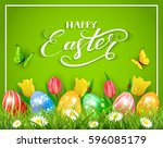 easter eggs in grass on green... | Shutterstock . vector #596085179