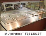 stainless serving table in a... | Shutterstock . vector #596130197