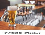beer glass on a bar table. beer ... | Shutterstock . vector #596133179