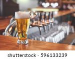 beer glass on a bar table. beer ... | Shutterstock . vector #596133239