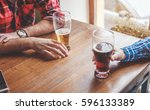 hands holding glasses with beer ...   Shutterstock . vector #596133389