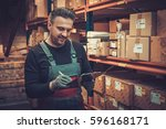 storekeeper with manual pick... | Shutterstock . vector #596168171