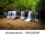 Peaceful Forest Waterfalls Landscape Flowing in Summer - stock photo